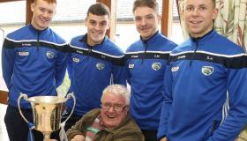 Triumphant Laois Gaelic footballers celebrate League GAA win with senior citizens