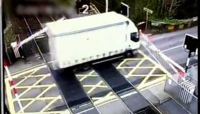 WATCH: Irish Rail shares footage of a lorry ploughing through level crossing barrier causing delays