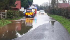 WATCH: Cars attempt this deep flood outside a Laois town where houses and schools were hit