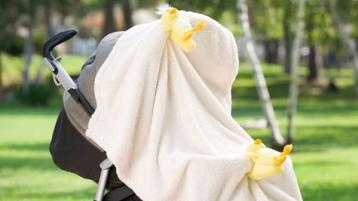 Warning issued to parents about dangers of covering baby's pram during hot weather