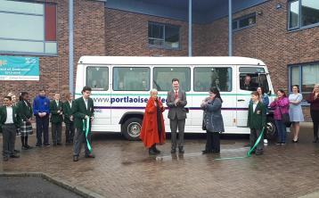 Portlaoise College Principal Noel Daly cuts the ribbon for the new school bus, with Anne Fitzpatrick, Enva and Louise Dent, Parents Council, helped by students Fabien Anghene and Hristo Petrushkov.