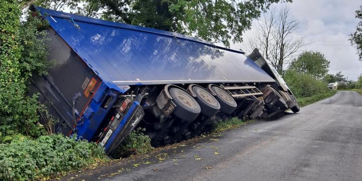 PHOTOS:  Truck overturned on narrow Laois road