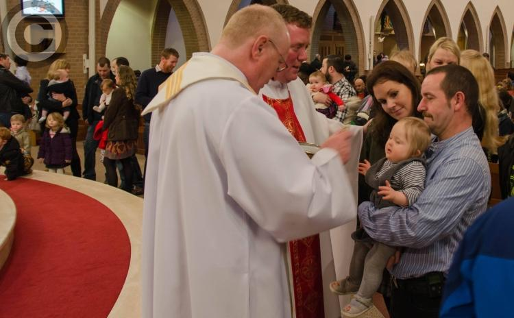 Family celebration at the Blessing of Babies in Portlaoise