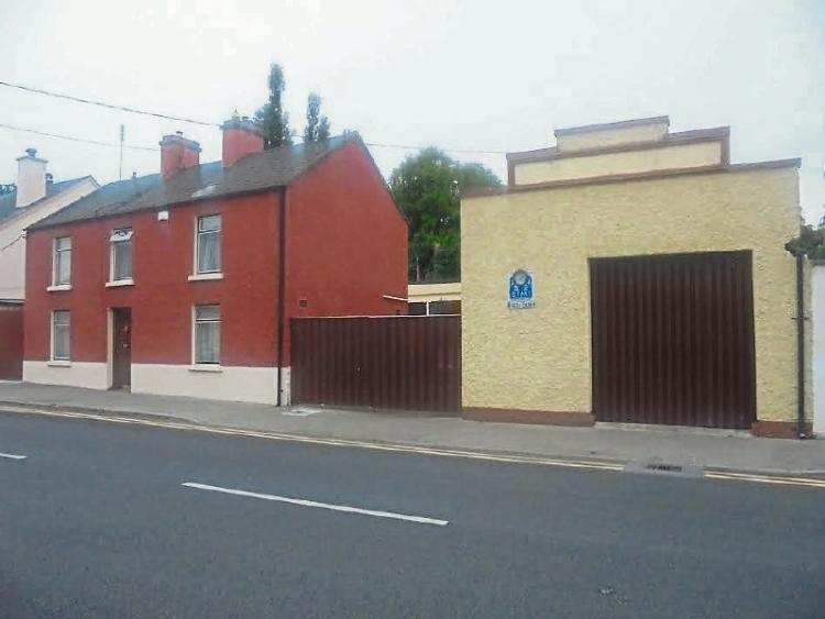 Mountrath town house with commercial style premises for for Industrial style house for sale