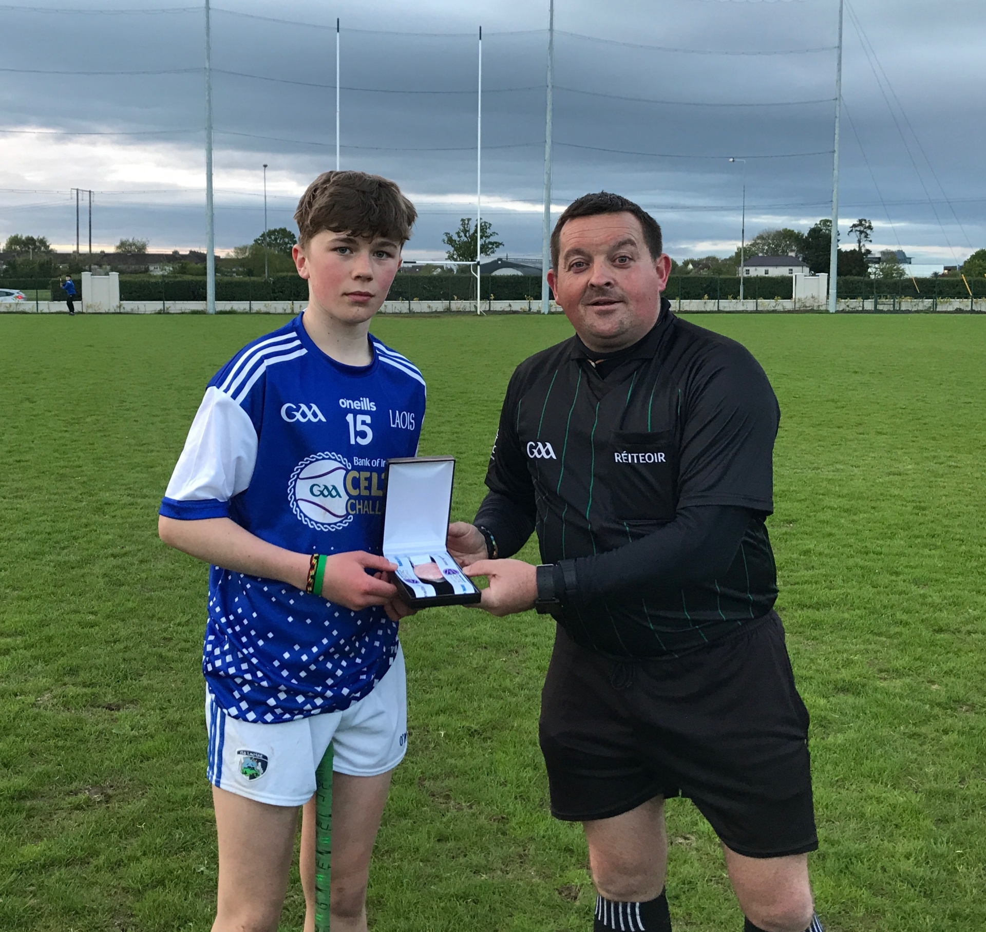 Laois' Cillian Dunne receiving his Best & Fairest award from the match referee.